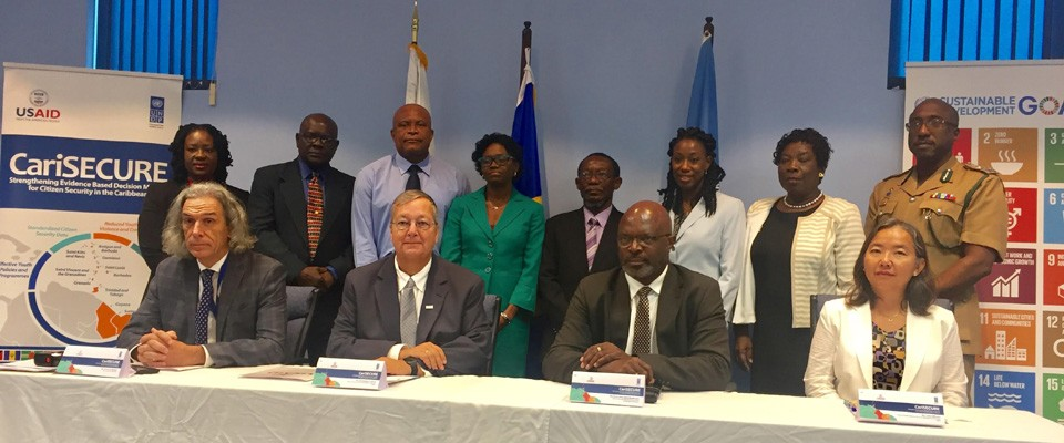 Barbados' Attorney General Mr. Adriel Brathwaite (front row 2nd right) , Ms. Chisa Mikami, UNDP Deputy Resident Representative for Barbados and the OECS (extreme right), Christopher Cushing USAID Mission Director (2nd left) and Paolo del Mistro, Team Leader, CariSECURE Project (extreme left) shown with members of the CariSECURE Barbados Task Force.