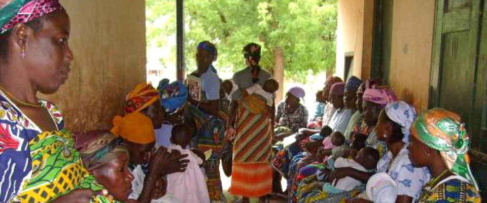 Ghanaian women learn how to prevent and treat malaria.