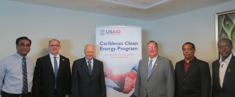 USAID Mission Director Christopher Cushing (4th left) other USAID staff and CARCEP officials pose for a photo following the work