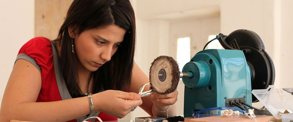 A girl attending a jewelry making course at Dar Al-Kalima College in Bethlehem
