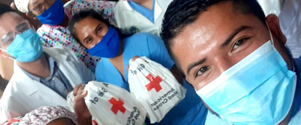 Group of people from Nicaragua wearing masks and holding basic hygiene kits with the help of LEPP donations.