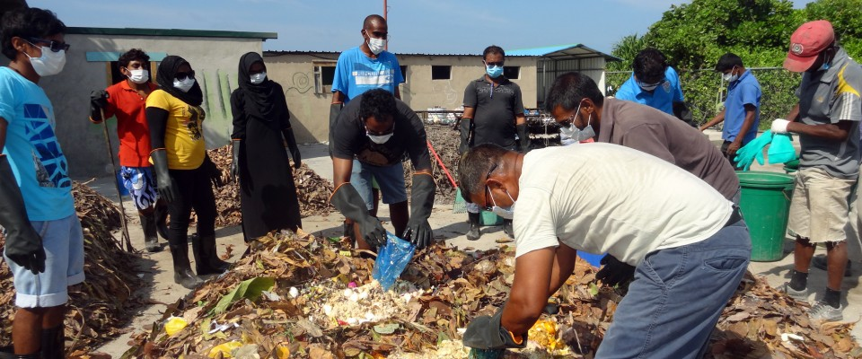 Local residents  gain knowledge and hands-on experience on preparing a compost pile