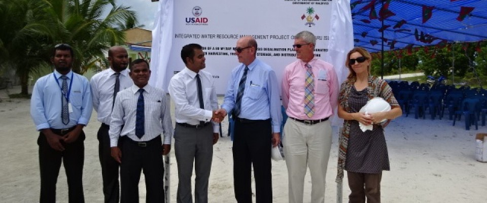 Dignitaries and USAID representatives pose for a photograph after the groundbreaking for a desalination plant in Hinnavaru