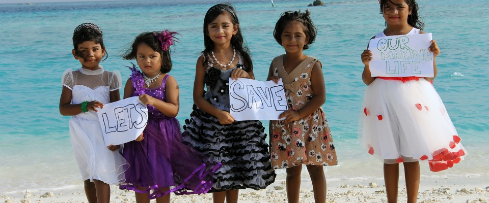 Young girls in Maldives' stand up for marine life at a USAID supported youth workshop on environment and water management