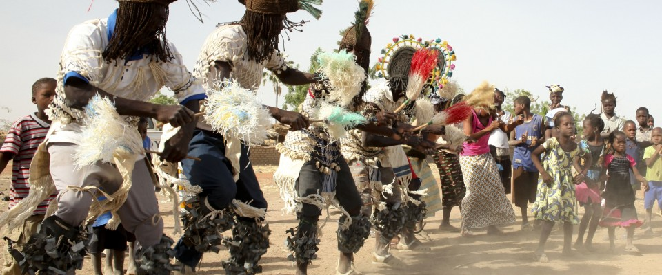 Traditional Bobo dancers greet USAID/Mali partners in Segou region.