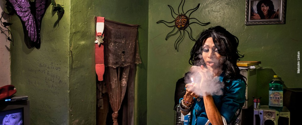 A transgender person smokes in her room in Mexico