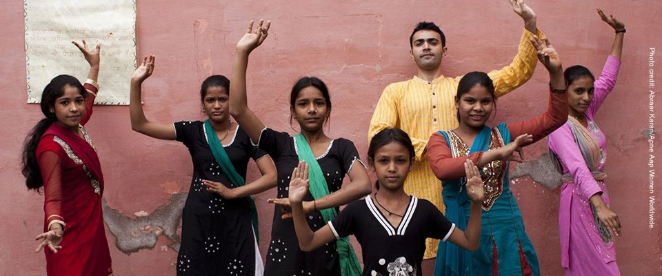 These youth in the Perna community are posing in a traditional bhangra folk dance stance