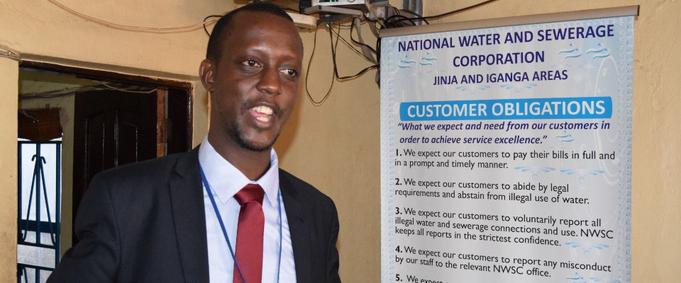 Paul Isagara, Iganga Area Manager for the Uganda National Water and Sewerage Corporation, speaking at a customer engagement workshop. Photo Credit: USAID/East Africa