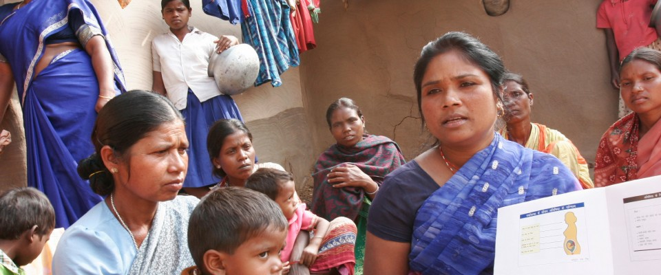 A USAID-supported health worker discusses reproductive health with village women in the state of Uttar Pradesh.