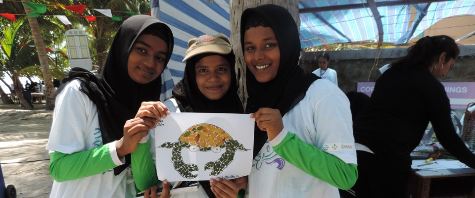 Students show creations made out of recyclables in Mathiveri, North Ari Atoll, Maldives