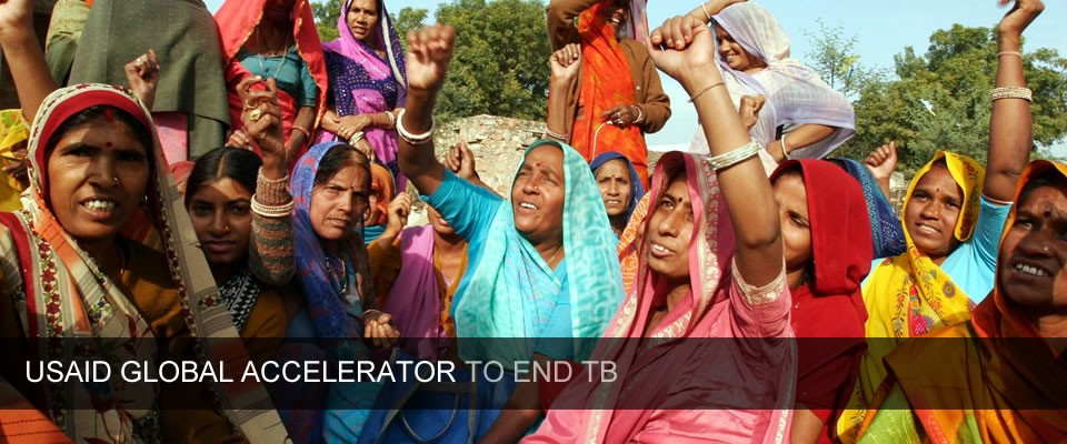A group of Indian women raise their hands in solidarity against TB. Caption reads: USAID Global Accelerator to End TB