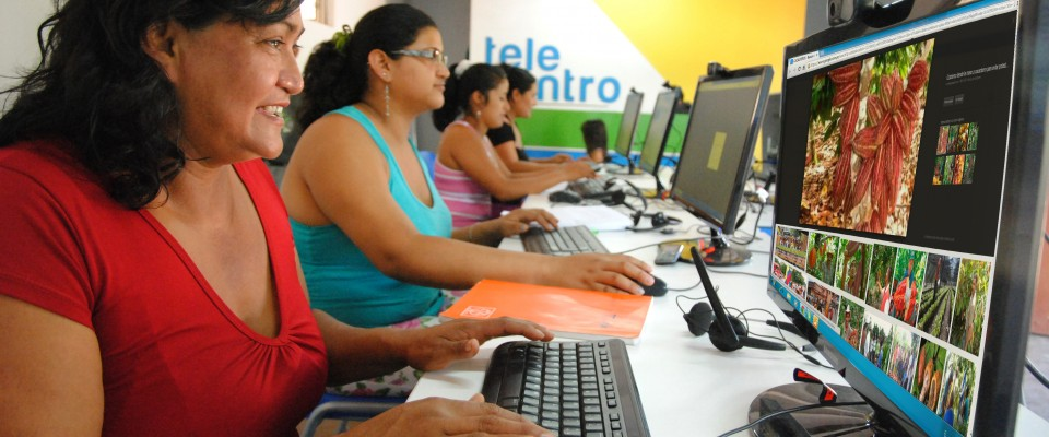 Women receiving digital and financial literacy courses at the Telecenter.