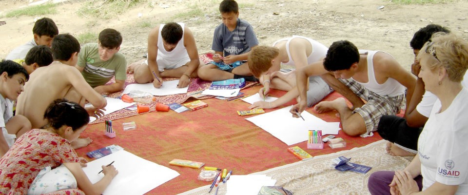 Youth create posters at a USAID-supported counter-trafficking seminar in Turkmenistan.
