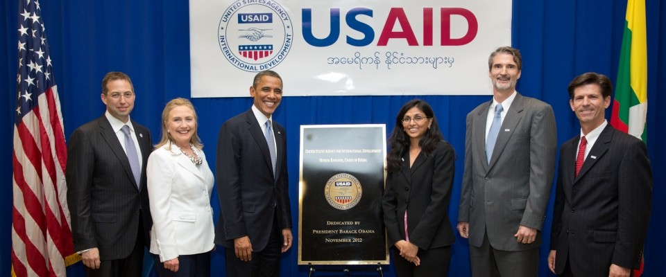 President Barack Obama and Secretary of State Hillary Rodham Clinton pose for a photo with USAID staff at the U.S. Embassy in Ra