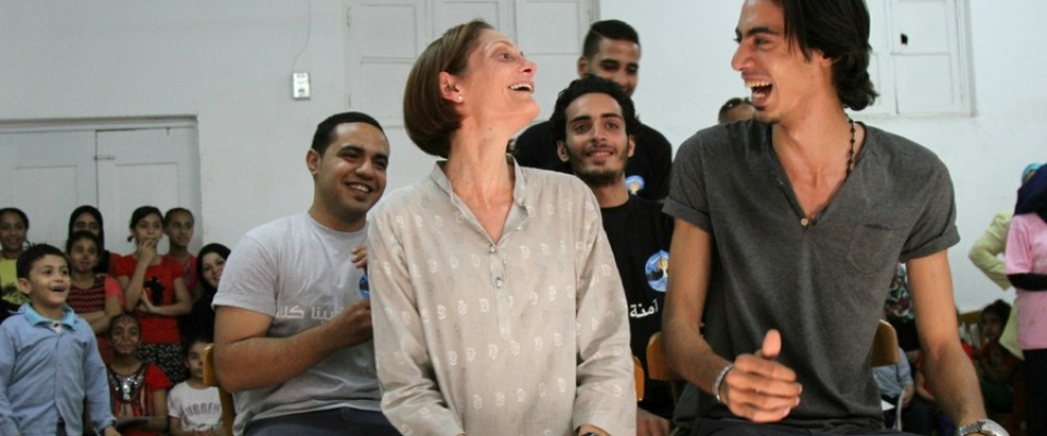 USAID/Egypt Mission Director Sherry F. Carlin role plays with community volunteers from UN Women's Safe Cities project