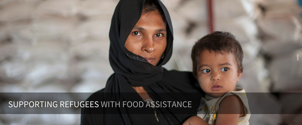 A mother holding her child - Supporting refuges with food assistance