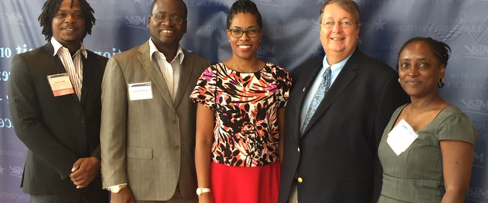 USAID Mission Director Christopher Cushing (second left) is joined by Janelle Lewis, Chloe Noble, Courtney Samuels, and Pierre L