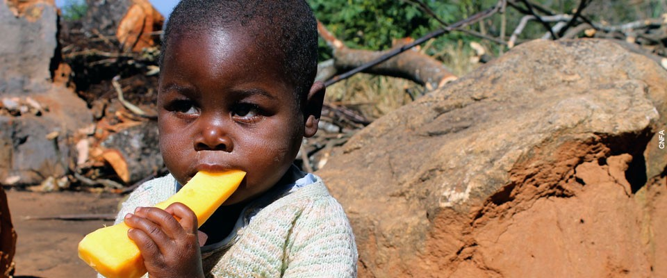 A child eats fruit in Mozambique