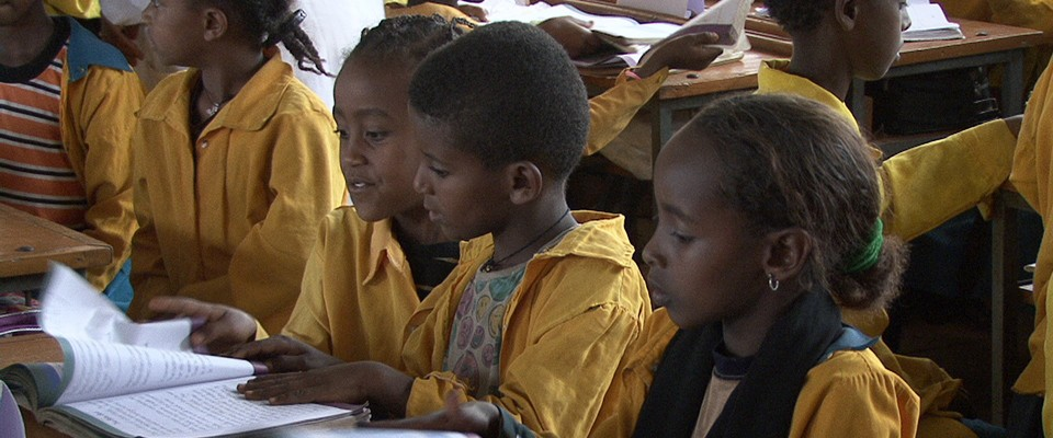 Girls are learning to read at the Kezira Primary school in Dire Dawa. USAID is focusing on improving teaching and reading outco