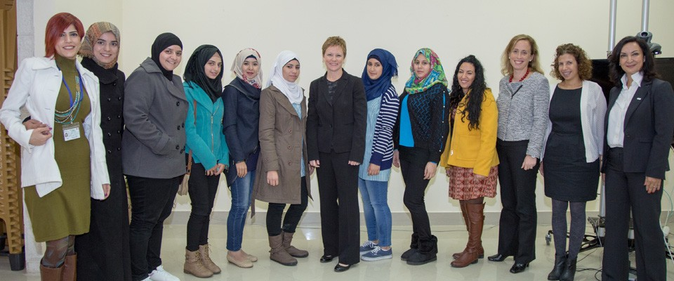Susan Markham takes a photo with participants of a youth council roundtable in West Bank, Gaza. / Global Communities