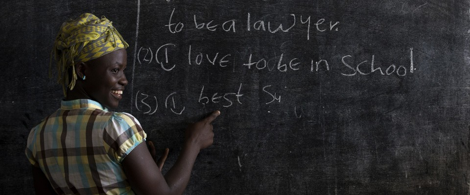 Liberian teacher before a blackboard