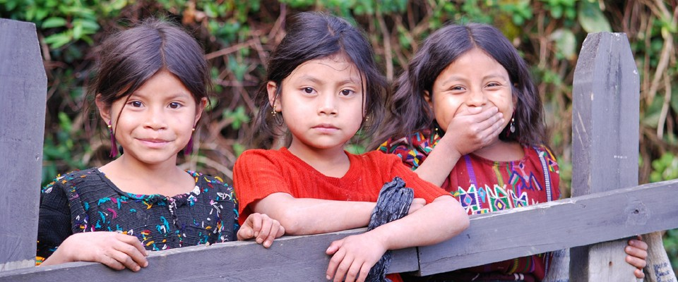 Ixil Mayan girls pose for a photo