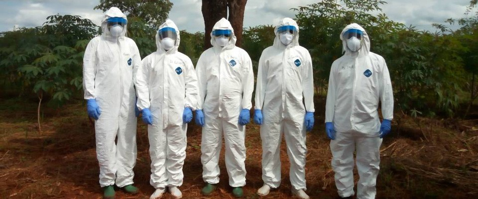 A group of people in PPE gear
