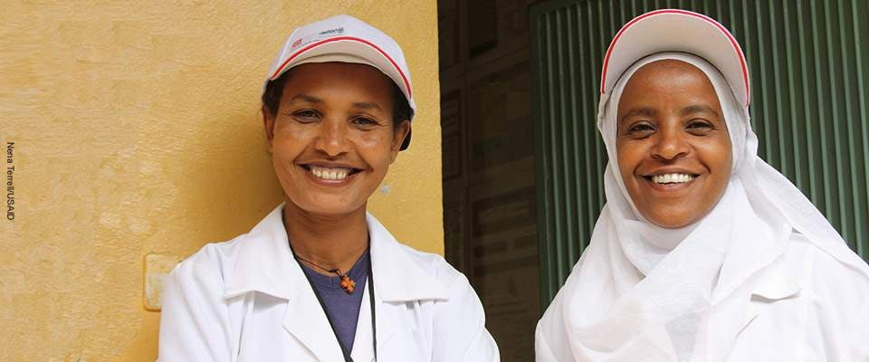Two health workers smiling