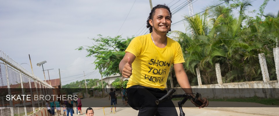 Jessel Edgardo Recinos rides a bike in the streets of Honduras