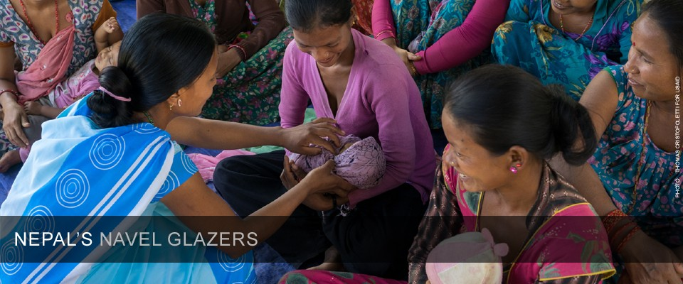 A health worker in Nepal teaches a group of mothers about maternal and child health