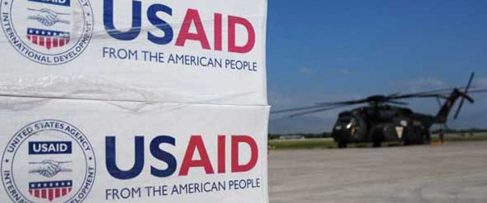 A USAID sponsored relief helicopter delivers supplies. USAID provides assistance to countries all over the globe.