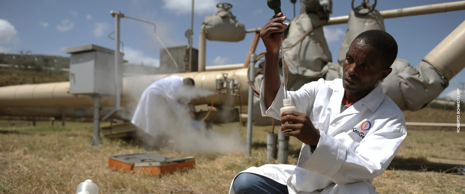 Kengen workers test a sample of condensed steam at a separator unit of a super heated steam well at the Olkaria geothermal plant