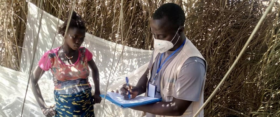 A health worker teaches malaria safety