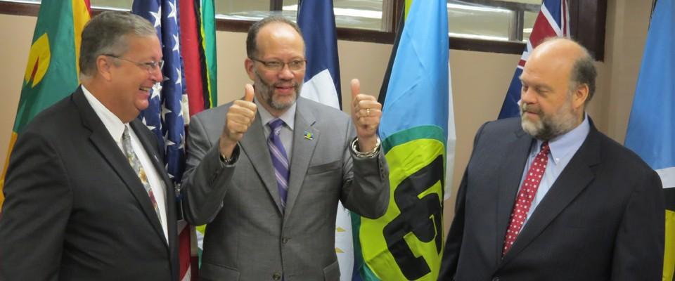 Elated CARICOM Secretary General Ambassador Irwin LaRocque gives a thumbs up following the signing