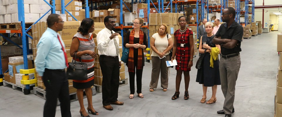 Officials tour the new Supply Chain Management Complex in Guyana during the close out of USAID's Supply Chain Management System