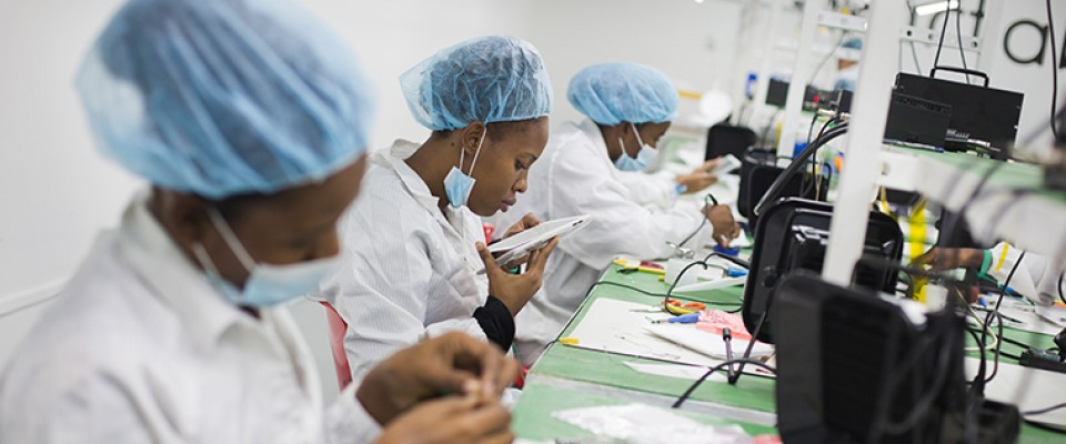 Employees assemble tablets at the Surtab factory in Port-au-Prince, Haiti.