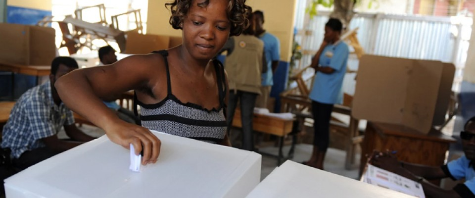 A Haitian woman casts her vote