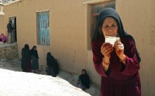 A woman poses for a photo after casting her vote in Daikundi province, June 14, 2014.