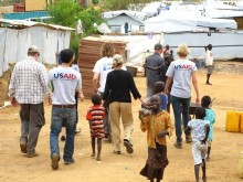 AA/DCHA Nancy Lindborg visits an UNMISS compound were some of the nearly million displaced men, women and children have fled for