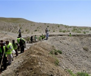 Workers build an irrigation canal in Khairkut District, Paktika Province.