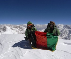 """""""Afghans to the Top."""" Amriddin Sanger (L) and Malang Daria (R) at the summit of Noshaq in July 2009."""
