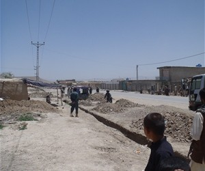 Sherzad, a police officer, keeping watch as he escorts CADG personnel to a project site in Qalat, Zabul Province