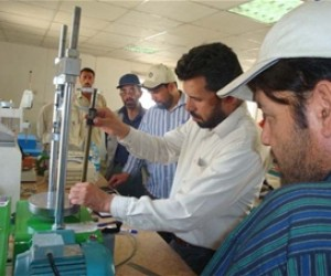 Engineer Mohammad Ashraf, manager of the Kabul Central Laboratory, demonstrates one of the quality control instruments employed