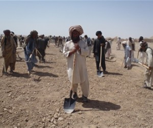 Workers improve the road that will improve transportation to Kandahar.