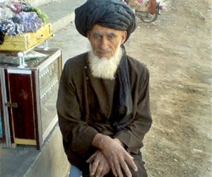 Ghafoor Jan, sitting in front of his shop, in downtown Tirin Kot, the provincial capital of Uruzgan. The street was cleaned by m