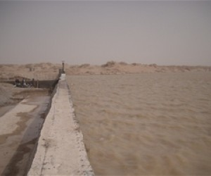 A 170-meter reinforced concrete irrigation weir, or check-dam, across the Khashrod River regulates the flow of historically unru