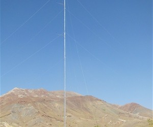 A 50-meter meteorological tower at Jabal Saraj dwarfs the work crew that just erected it.