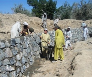 Workers repairing a wall along the canal. The canal project employed 1,395 workers.