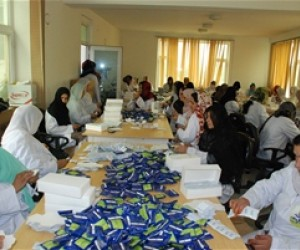 Widows repacking health products to support themselves and thier children