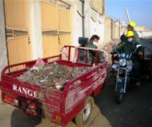 Zarangas pick up trash from one of Mazar-e-Sharif's neighborhoods.